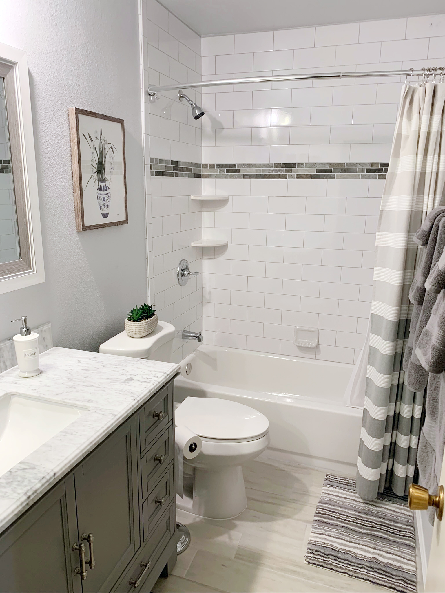 bathroom remodel with white subway tiles. Clean and crisp design.